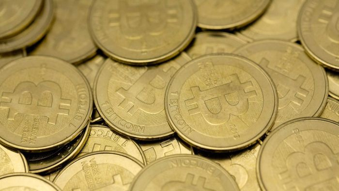 The taxman is after your bitcoin profits — though the law is a grey area