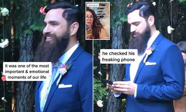 Husband-to-be is slammed after checking his phone while his fiancée walks down the aisle