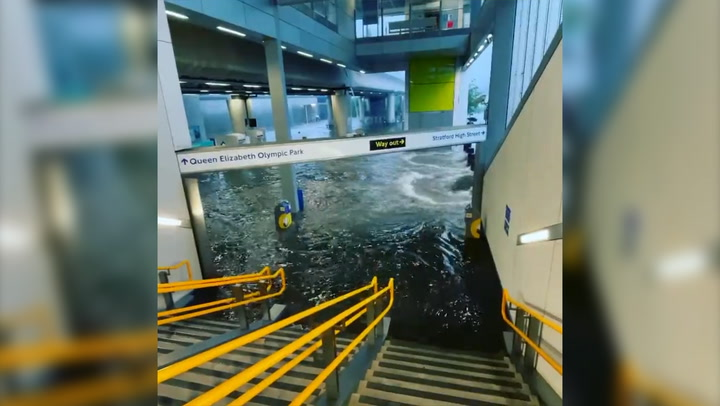 Water gushes into London tube station in flash floods