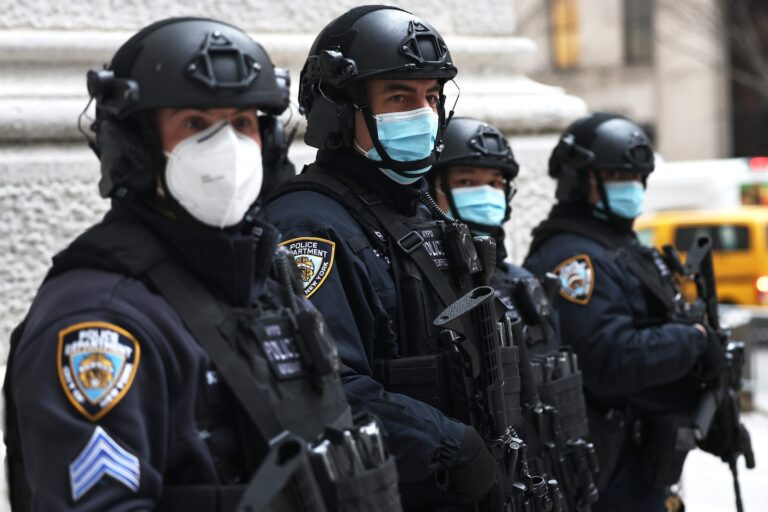 Covid-19 live updates: Fauci urges police officers to get vaccinated as union protests heat up